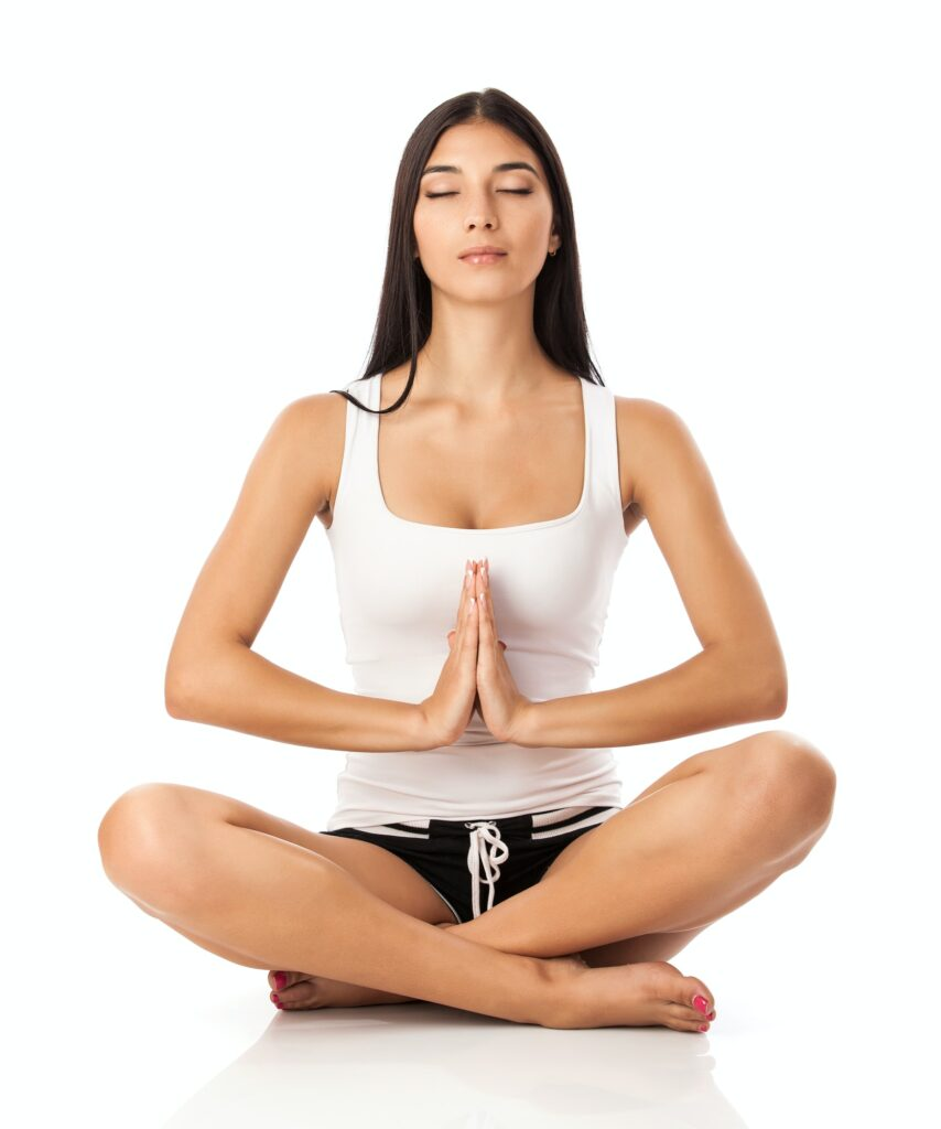 Young woman sitting in lotus position - learn kung fu online