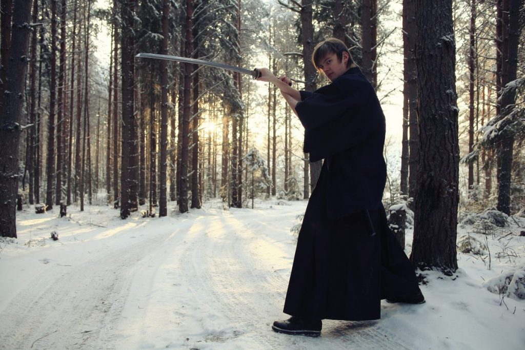Man training weapons in snow forest - learn kung fu online