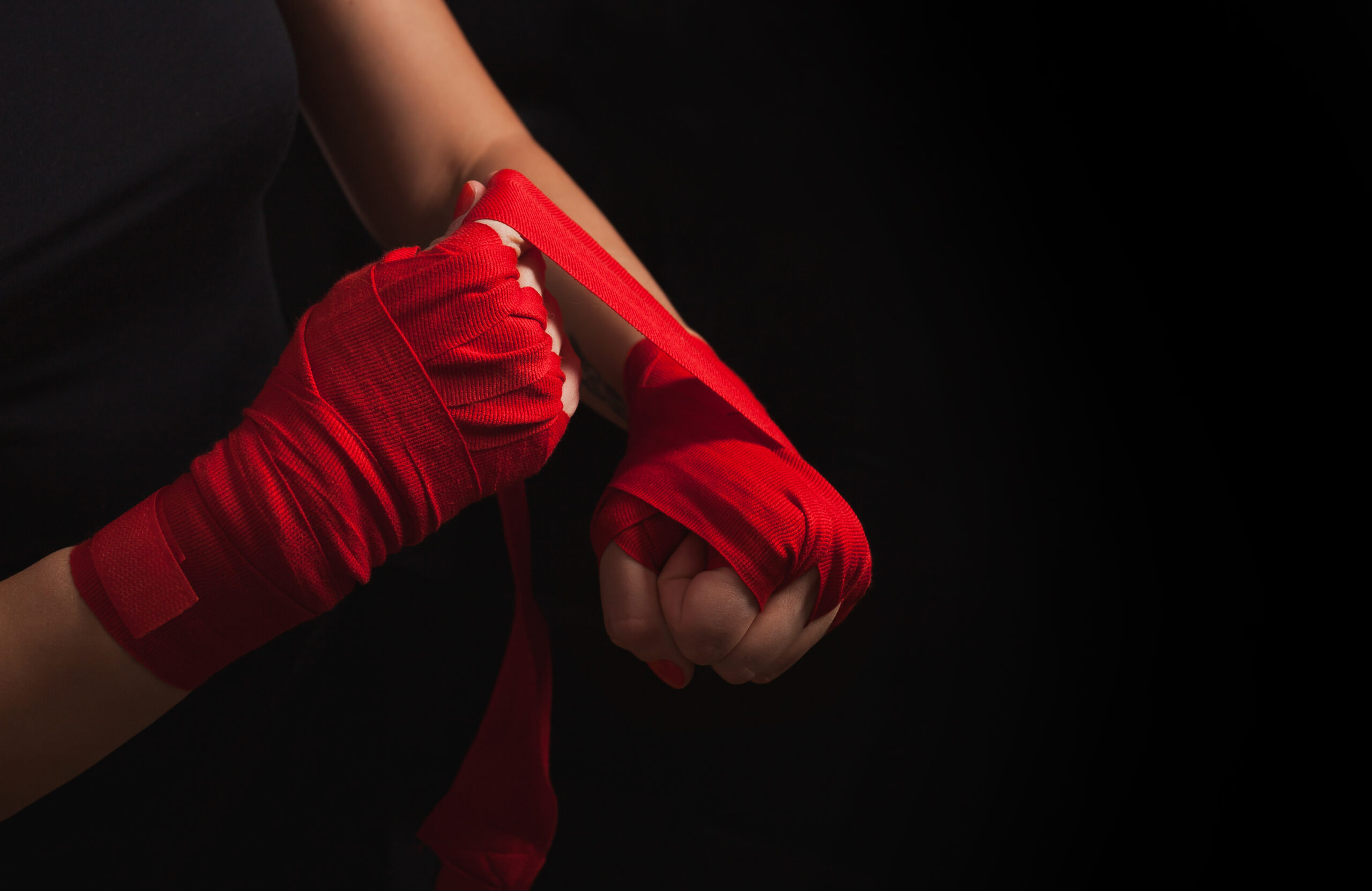 martial art woman wrapping hands ready for training - learn kung fu online