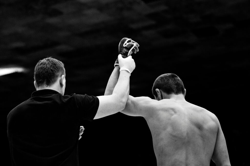 referee lifting hand of winner fighter - learn kung fu online