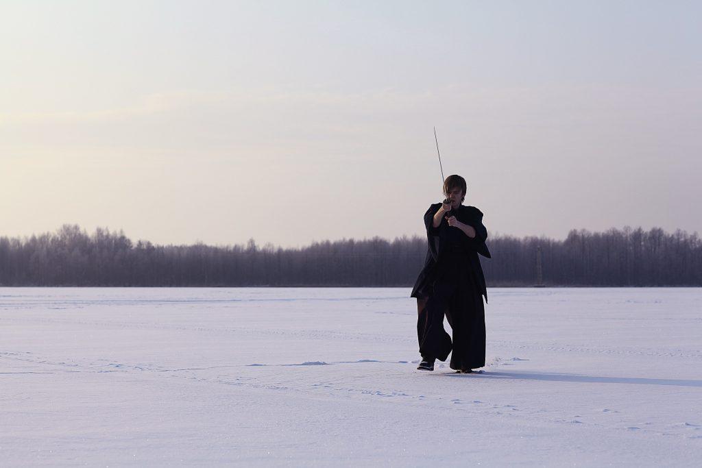 martial artist training in snow