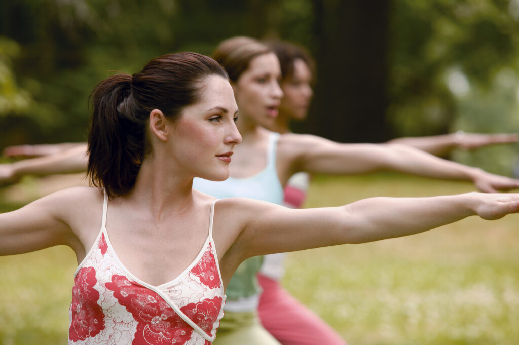 women doing warrior pose while yoga training - learn kung fu online