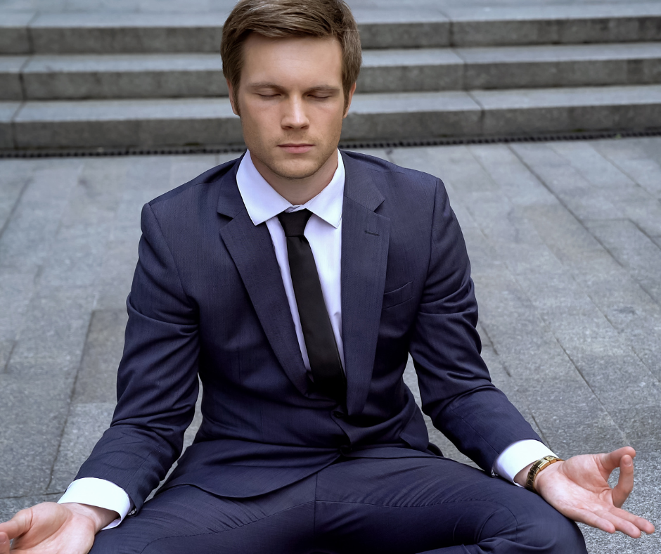 Man in suit meditating