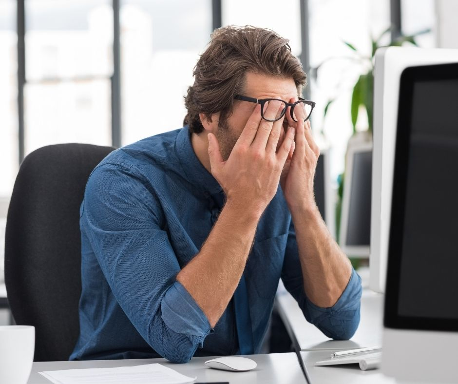 man at desk stressed